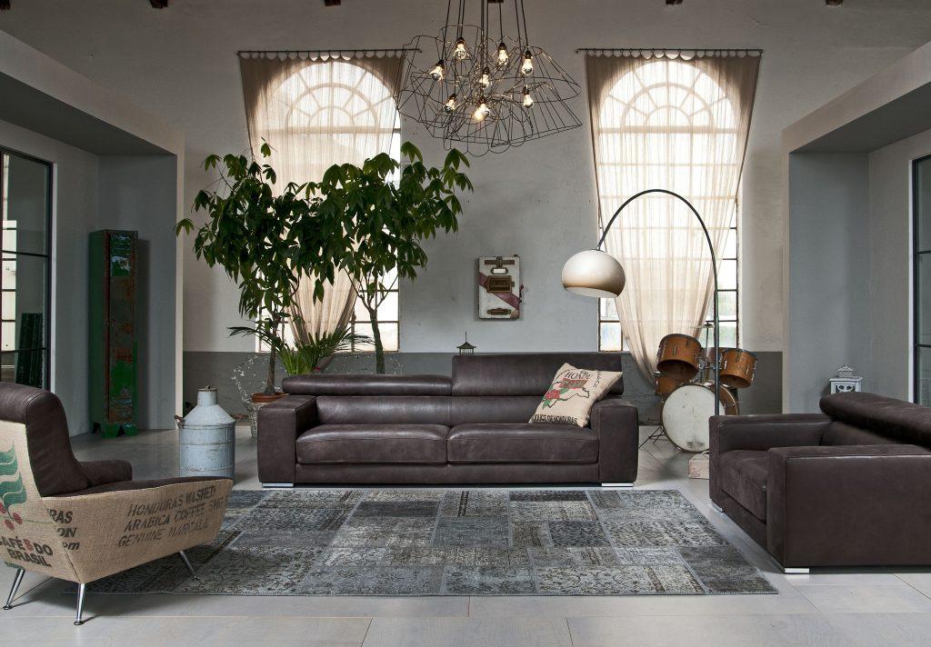 Divano moderno angolare con poggiatesta reclinabile con sedute scorrevoli lineare pelle e tessuto, modello Vilnius   Gobbo Salotti