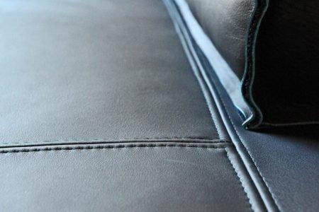 Divano design moderno vintage angolare lineare con schienale mobile pelle e tessuto, modello Alan | Gobbo Salotti